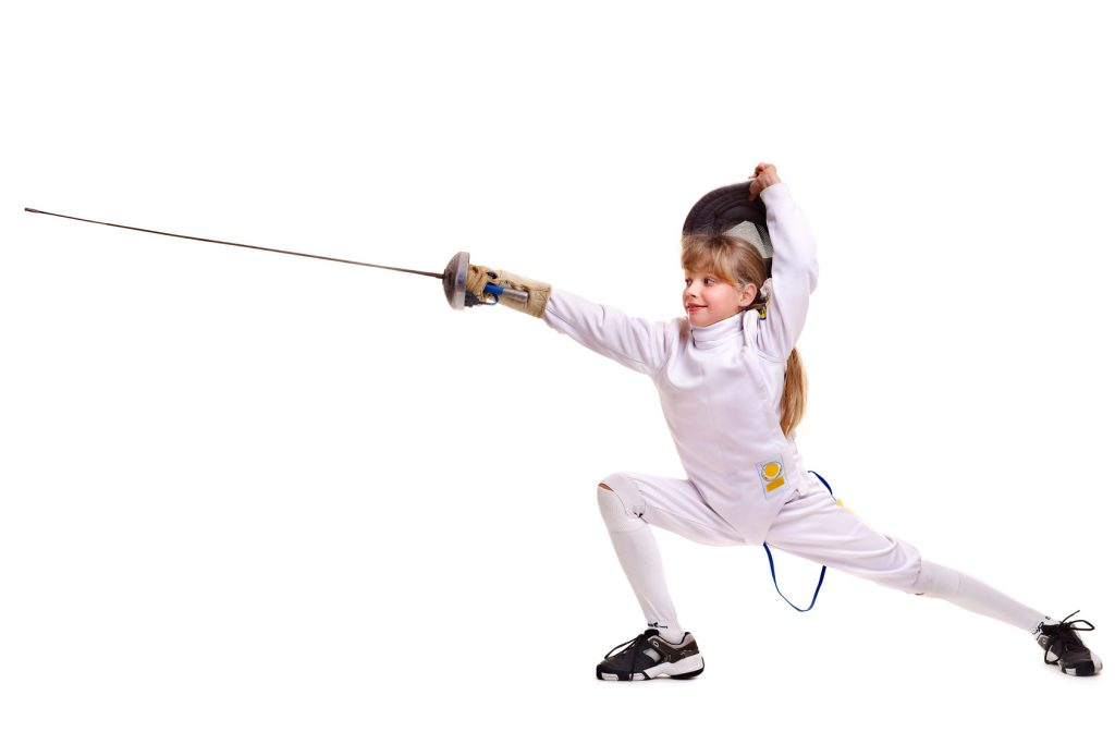 Child epee fencing lunge.